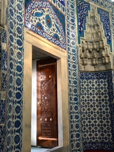 The tile work and wooden inlay door are spectacular!