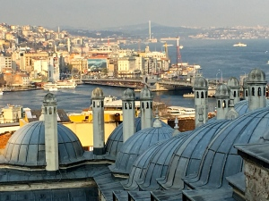 The Süleymaniye mosque complex looks out over the city. In the distance, you can see the Galata Bridge crossing over the Bosphorus Strait.