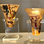Cups from the same era. The colors and paintings on the glass are adorably cartoonish. I swear the figure on the right looks like a character from The Simpsons.