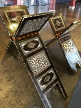 A pair of gorgeous Quran holders, inlaid with mother-of-pearl, tortoise shell, ebony, and ivory. My great grandmother had a small tabletop Bible stand that looked similar.
