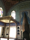 The Privy Chamber of Sultan Murat III is considered one of the oldest and finest rooms in the palace (1578 - 1590). It boasts Iznik tiles, marble shelves, cabinets with mother-of-pearl and tortoise-shell inlaid doors, and a fireplace with a gilded tombac hood. The Baldachin throne -- the thing that looks like a canopy bed -- dates from the 18th Century.