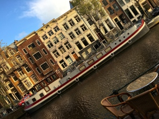 Larger canals are home to Amsterdam's many houseboats. Check out this nautical mansion. It barely fits in the frame.