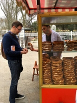 Matthew partakes from one of the Turkish bagel carts.