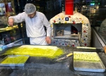 A chef prepares a fresh batch of baklava for the lunchtime crowd.