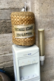 I love this basket-weave jacket for the water cooler at a nearby mosque. The sign says the local pharmacy has provided the water as an act of charity. Charitable care-taking of the poor and needy is one of the five precepts of Islam.