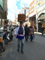 "This guy is carrying a load of ""simit"" (Turkish bagels) to his street cart. Covered with sesame seeds, these treats are a traditional breakfast food."