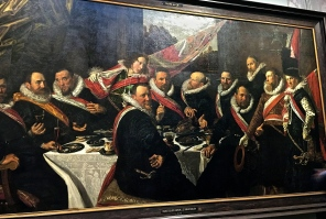 "The ""Banquet of the Officers of the St. George Civic Guard"" has that characteristic lifelike trademark of Hals' work. You feel as if you've just interrupted the frat boys at their kegger. And from the mocking looks on their faces, they're not particularly impressed with you. The Civic Guards were wealthy merchants, bankers, and tradesmen who'd been elected by citizens to protect the city in case of attack. Methinks meetings were mostly an excuse to party. Hals, Rembrandt, and other Dutch Masters painted lots of Civic Guard portraits during their careers."