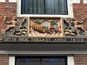 Many of Haarlem's buildings still have their original signs over their doors. Most have not only text, but also images describing what they do for folks who couldn't read. Here, the beer barrel advertises that this establishment was an inn that served from a Toelast (a 600-liter barrel of beer). Architect Lieven de Key, who designed the Vleeschhall, built this inn in 1609.
