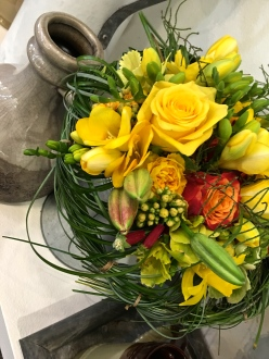 "Check out the woven nest of Bear Grass used to create the bouquet holder for this bundle of blossoms. A panel of expert judges awards prizes not only for the best arrangement, but also for the ""Best in Breed."""