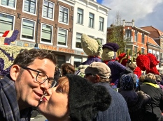 "Matthew takes a peek while trying perfect our ""Kissing Delft Dutch Couple"" pose (note the float in the background.)"