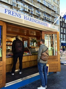 Matthew tries out one of Amsterdam's famous herring stands, where you can get your herring pickled, raw, curried, or doused in mustardy mayo.