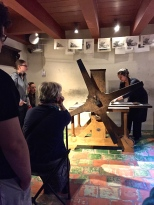Here, an artist runs prints on a replica of Rembrandt's press using copies of some of his etchings. Pretty amazing stuff.