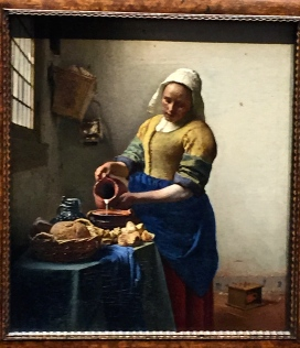 "Vermeer's ""The Kitchen Maid"" is so lifelike that you feel as if you're voyeuristically peering through a window. In fact, it's possible that Vermeer did just that, using a camera obscura to project a real-life image onto his canvas, then copying it almost like a paint-by-numbers. If you haven't seen the movie ""Tim's Vermeer"" explaining his probable technique, rent it today."