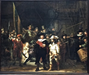 "Rembrand's famous painting nicknamed ""The Nightwatch"" shows his characteristic mastery of movement and chiaroscuro (the play of light and shadow to create moodiness and drama). Up close, it's amazing how much his dabbling brushwork resembles impressionist techniques."