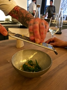 The chef showers our pork tartar with shredded egg yolks.