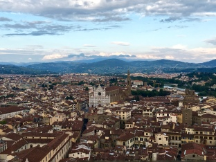 The magnificent view from the Palazzo Vecchio shows Sante Croce Church, the Arno River, and the Tuscan hills in the background.