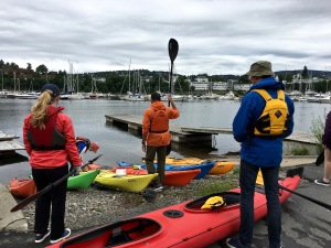 First order of business: grabbing paddles and donning life jackets and water shoes, then sorting out who gets the single kayaks and who gets the doubles.