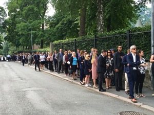 Note the breadline of guests waiting to enter the U.S. Embassy's July 4th picnic. After check-in and the usual security protocol, guests received pins sporting American and Norwegian flags (see our lapels up top.)