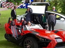 Everybody wanted to get their pic taken in the Polaris Slingshot SL, a two-seater, three-wheeled motorcycle.