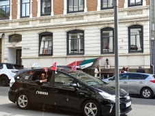 Taxis get in on the action by flying the Norwegian flag.