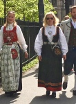 Bunader (the plural of bunad) reflect the ancestry of the wearer. I think the woman on the left is sporting a bunad from Hardanger, while the woman on the right shows off a Gudbrandsdalen bunad.