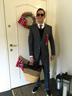 Matthew sports the appropriate attire for the day, plus flags and a basket full of wine.