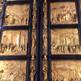 "Ghiberti so impressed the guild with his work on the north doors that he was awarded the commission of the east doors pictured here, which took another 27 years to complete. For this set of portals, Ghiberti used ""rilievo schiacciato"" (meaning ""flattened relief"") -- a method invented by Donatello -- to create incredible 3-D compositions depicting Old Testament stories. Michelangelo himself was so impressed with Ghiberti's work that he nicknamed the doors the ""Gates of Paradise."""