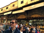 "Originally a meat market, the Ponte Vecchio was converted into a kind of ""jewelers' row"" during the Medici era. You can see it's still a popular spot for shoppers today."