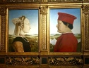 "Piero della Francesca, geometrician and master of perspective, painted this pair of portraits. They depict the Duke and Duchess of Urbino -- he's one of the leaders who inspired Machiavelli's work, Il Principe. The Duke is always portrayed on his ""good side;"" he had acquired a huge scar and lost an eye in a tournament. Possessing only one eye hampered the Duke's aim, so he had surgeons carve away the bridge of his nose to improve his field of vision. His wife, who he described as ""the delight of my public and private hours,"" died at age 25 after the birth of their seventh child. Considered a beauty, she had bleached hair and a plucked hairline to raise her forehead. Her white skin reflects the fact that the portrait was done post mortem."