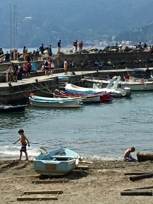 A breakwater protects Vernazza's natural harbor and a tiny stretch of sand that acts as a boat launch and kiddie play pool. But during winter, the sea can be so rough that waves can come crashing over the breakwater, flooding the harbor area and carrying away unsuspecting bystanders.