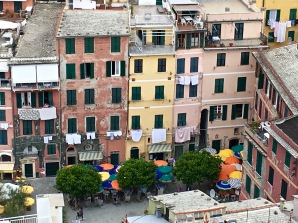 "Cinque Terre sits at the south end of Liguria, a coastal region headed by the city of Genoa. The district government appoints a ""commissioner of good taste"" who regulates the Ligurian Pastel colors of Cinque Terre's buildings."