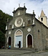 The Church of San Giovanni Battista dates back to 1341, but its façade was rebuilt in 1820. San Giovani (St. John the Baptist) is the patron saint of Genoa, the maritime republic that once controlled the region. The white rose window is made from Carrara marble (the Carrera mines are nearby.)