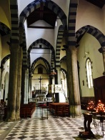 The pretty church interior contains a wooden crucifix that, on Corpus Domini (six days after Easter), gets carried down to the harbor for a service. The black-and-white-striped lancet arches are typical for Ligurian Gothic architecture.