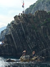 Only the young are brave enough to dive from the steep harborside cliffs.