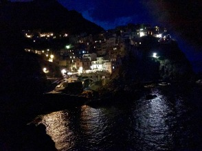 The sky over Manarola shows the fading flash of a bolt of lightening leftover from the storm out at sea.