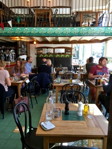 """Despite a number of empty tables, this place was """"completely booked"""" due to the general restaurant policy of holding reservations for three hours."""