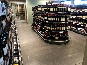 In an effort to generate tax revenue and manage alcoholism, state-controlled Vinmonopolets are the only licensed vendors of alcohol greater than 4.75%. They provide an astonishing array of wines (note the fine-vintages section in the background of this photo.)