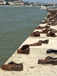 A row of 50 bronze shoes commemorates Hungarian Jews who were massacred during the WWII Holocaust. To save on bullets, Nazi collaborators tied several Jews together, but shot only the first few in the lineup -- so that as they fell dead into the river, they dragged the others in behind them. Around 600,000 of Hungary's Jews lost their lives during the war.