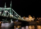 The Chain Bridge ends at the Gellért Baths, both of which are beautifully lit at night.