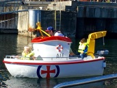"""The Elias Rescue Company gave tours of their new, state-of-the-art rescue boat, while the kiddies caught a ride aboard """"Alf."""" (I was bummed to be too big to fit on board.)"""