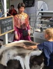 Reindeer pelts for sale -- hey kid, you pet it, you buy it.
