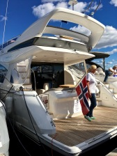 """The Princess 43 Motor Yacht is classed as a """"superyacht"""" -- at the super price of $660,000 USD. I like to think of it as the ultimate party barge, with a deck (and bar) in back, on the bow, and up top."""