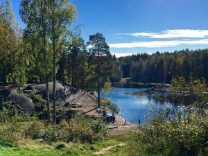 """Families gather at the waters edge of Ulrudsvannet """"badeplass"""" (bathing place), but no one seemed brave enough to go for a swim."""