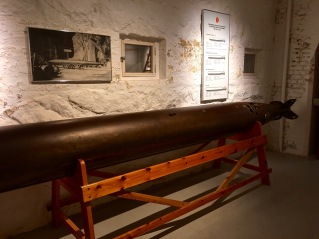 Oscarborg's Austro-Hungarian Whitehead torpedoes carried 100-kg TNT warheads that dated back to 1900 -- the last time the fort received a serious upgrade. The torpedoes had been successfully practice-launched more than 200 times, but no one was sure they would actually detonate, due to their age. While the torpedoes' speed could be set, targeting had to be done via dead reckoning (estimating the distance and speed of the target visually.) A few days before the Nazi invasion, the regular torpedo commander became ill. So the Navy had to call in the nearest local expert, Commander Andreas, who had retired 13 years earlier.