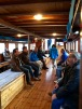 Our team admires the boat's jaw-dropping views and woodsy interior.