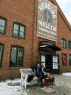 Outside the factory outlet, fur pelts and a fire pit provide shoppers with a warm respite.