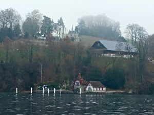Check out the castle crowning the hill with its own attached chapel and a boathouse made to look like a chalet.