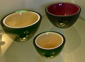 I'm crazy for these bowls, with their simple, pure shape and metallic finish. By the way, adding metallic oxides is what gives color to basic clear glass. Iron and chromium oxides produces the color green, while selenium and gold oxides produce red. Sulfur and metal sulfides produce yellow.