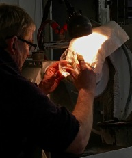 "A worker etches the details into what will become a white wineglass in Hadeland's Finn (""find"") Line of crystal."