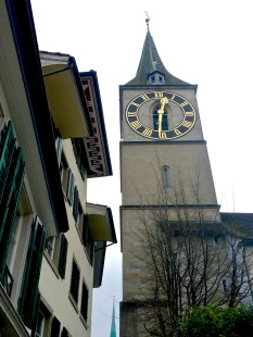 St. Peter is Zürich's oldest church, having been founded in the 7th century. At 28 feet in diameter, its clock face is one of Europe's biggest. The town watchman once lived above the clock. If he spotted a fire, he'd ring the bell and hang a flag out whichever clock window faced the blaze.